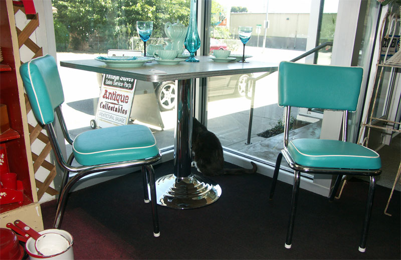 From The 1950s, It Has 2 Chairs, And Has Been Reupholstered In Aqua And  White. The Table Is Gray.
